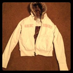 A&F Zip-up Hoodie A&F Zip-up Hoodie- cream with tan embroidery EUC, lined with fur. Will negotiate with reasonable pricing !  Abercrombie & Fitch Jackets & Coats