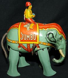 "Tin lithograph elephant and rider windup toy ""Jumbo"" - I want one! . . . Jumbo rarely has a rider. . . this one's AWESOME!   .....................................Please save this pin.   ............................................................. Click on this link!.. http://www.ebay.com/usr/prestige_online"