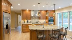Cherry Wood Cabinet Kitchen - cherry cabinets, granite countertops, built in appliances, tile backsplash, island seating for three. Cherry Wood Cabinets, Wood Kitchen Cabinets, Island With Seating, Granite Countertops, Backsplash, Kitchen Ideas, Tile, Kitchens, Appliances