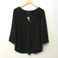 Playful Black Blouse with Lace and Pleats Dress down with denim or play it up with bold accessories.  The color is darker than what is shown - I brightened the image to show the detailing.    100% polyester.  Machine wash.  Smoke free home. American Eagle Outfitters Tops Blouses