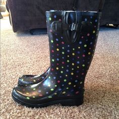 NWT.  Western Chief rain boots. Never been worn. New with tags.  Western Chief rain boots.  Color Ditsy Dots-multi.  Small tear pointed out in the last photo. Western Chief Shoes Winter & Rain Boots