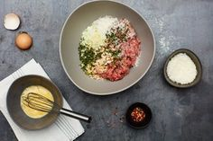 Making Italian meatballs with 3/4 pound ground beef, 1/4 pound ground pork, a handful of breadcrumbs, a handful of chopped onion and garlic, chopped fresh parsley and oregano, red pepper flakes, and Parmesan cheese.  / Photo by Chelsea Kyle, Prop Styling by Alex Brannian, Food Styling by Anna Stockwell http://www.epicurious.com/expert-advice/meatballs-without-a-recipe-article
