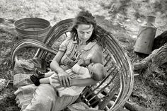 "Migrant Madonna: June 1939. ""Wife and baby of itinerant cane furniture maker and agricultural day laborer camped in Wagoner County, Oklahoma."" 35mm nitrate n..."