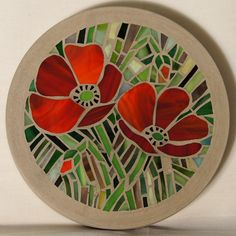 This concrete stepping stone garden feature is decorated with a stained glass mosaic featuring a Poppy design Each circular stone is ( just under ) across and about ( just over inches ) thick. It should be bedded in the garden in th. Mosaic Tile Art, Mosaic Crafts, Mosaic Projects, Stained Glass Projects, Stone Mosaic, Mosaic Glass, Glass Art, Mosaics, Pebble Mosaic