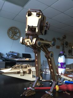Cool laser cut AT-ST walker with a snow speeder in the background.