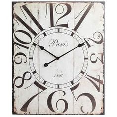 """Bring a touch of vintage-inspired style to your decor with this tin wall clock in distressed ivory, featuring a plank-inspired face.      Product: Wall clockConstruction Material: TinColor: Distressed ivory and black  Features: Quartz operating movementArrives ready to hang  Accommodates: (1) AA Battery - not includedDimensions: 28"""" H x 23"""" W x 1.5"""" D  Cleaning and Care: Wipe dry with a clean cloth"""