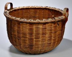 Skinner's - The Personal Collection of Lewis Scranton, Auction 2897M. May 21, 2016. Lot: 170.  Estimate: $400-800.  Realized: $800.   Description:  Large Shaker Basket, Enfield, Connecticut, 19th century, with two handles and double braid bottom, ht. 14 in.
