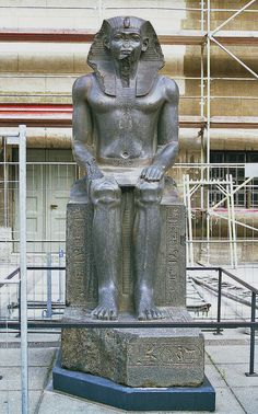 Sitting statue of Amenemhat II, later usurped by 19th Dynasty pharaohs. Berlin, Pergamon Museum