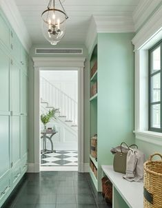 Welcoming mint green mudroom features a glass bell jar lantern hung from a white shiplap ceiling in front of mint green closed lockers located above drawers accented with polished nickel pulls. Mint Green Rooms, Mint Green Paints, Mint Green Decor, Mint Rooms, Green Paint Colors, Green Decoration, Mint Green Aesthetic, Mint Green Walls, Green Painted Walls