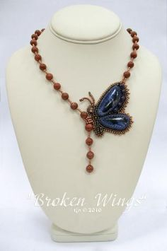 I like this shape of necklace with the use of a focal point as part of the support for the shape and as the clasp