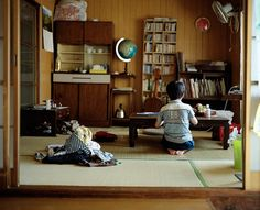 tatami room with table and bookshelves