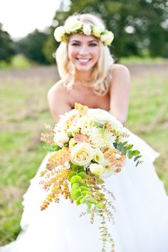 cascading white, yellow and peach wedding bouquet #weddingbouquet #whiteroses #bouquets http://www.weddingchicks.com/2013/10/30/vintage-peach-wedding-ideas/