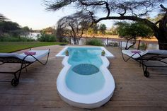 a swimming pool overlooking the river and a Spa @sasaab camp