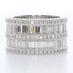 This ring is undeniably bold. 💎💎💎 Stacked is a 5-row wedding band, consisting of 10ctw diamonds... wow! ✨