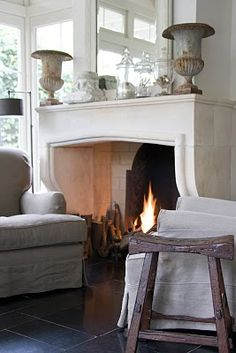 Tuscan style is all about rustic elegance; aspects of the room should look aged and time-worn, yet luxurious. Natural materials are ideal for creating this look, like stone and unfinished wood. #Tuscany #fireplace