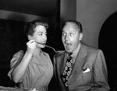Jack Benny visists Joan Crawford and can´t resist tasting Mildred Pierce´s daily special Tags: 1945, fun, Jack Benny, Joan Crawford, Mildred Pierce, visitor,