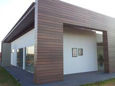 Fachada de madeira plástica encapsulada_empresas