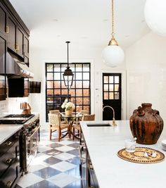 Black and White Kitchen with Brass Accents