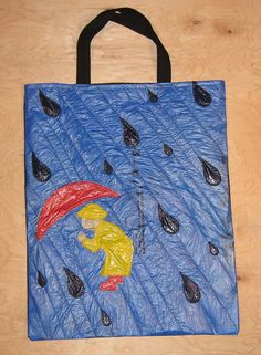 Rainy Day totebag    The front of this totebag is made from quilted and appliqued plastic bags. About five plastic bags went into the making of this plastic bag.