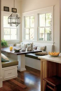 Two walls of windows brighten the cozy breakfast nook of the 2011 Southern Living Idea House. | thisoldhouse.com