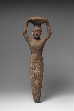 Foundation figure of Ur-Namma holding a basket  Period: Ur III Date: ca. 2112–2095 B.C. Geography: Mesopotamia Culture: Neo-Sumerian Medium: Copper alloy