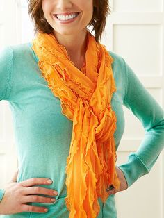 What could be simpler or more versatile? Make this scarf from two strips of ruffled knit fabric joined with two short seams (yes, just two!) and you're done in a jiffy.