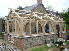 Timber framing construction is a method of building with heavy timbers. - Timber framing construction is a method of building with heavy timbers. Backyard Greenhouse, Greenhouse Plans, Great Buildings And Structures, Garden Structures, Types Of Timber, Framing Construction, Timber Structure, Timber Frame Homes, Glass House