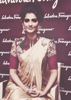 notable: sari blouse (cut and kaam) suggested change: plum or deep olive colored silk sari (not raw silk).