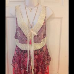 Free People Top Size 4 This is a pink floral Free People top with crochet trim in a size 4 Free People Tops