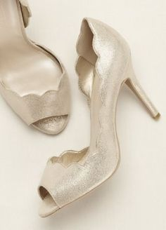 Complete your look with these stylish and feminine scalloped edge peep toe pumps!  Heel Height - 3 3/4 inch.  Available in Gold Metallic.   Fully lined. Imported.
