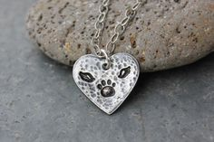For sweet memories of your little pet angel. This unique necklace features a handmade fine silver (99.9% pure silver) heart pendant hand stamped with a tiny little paw print with angel wings. The paw