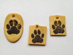 Geoswag. Paw stamp polymer clay pendant. --ontariocacher