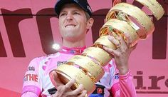 Pink jersey holder and overall leader Garmin-Barracuda's Hesjedal of Canada holds the trophy after the miles) time trial in the and last stage of the Giro d'Italia cycling race in Milan. Monument Men, Toronto Star, Italy Tours, Pro Cycling, World Of Sports, Grand Tour, World Championship, Cartier Love Bracelet, 21st