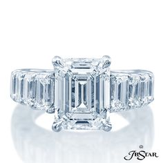 JB Star 5.01ct emerald-cut diamond center enhanced with emerald-cut diamond sides.