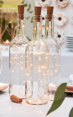 Cork Bottle Lights nAdd the perfect finishing touch to your home with some decorative lighting doll. Featuring dainty mini lights on a clear string, we're obsessed. Just add these to a cork bottle for an elegant touch. nDimensions: 7cm x 8.5cm x 3cm n Outdoor Wedding Decorations, Cheap Backyard Wedding, Outdoor Rustic Wedding Ideas, Inexpensive Wedding Centerpieces, Natural Wedding Decor, Beach Centerpiece Wedding, Backyard Wedding Receptions, Outdoor Wedding Lights, Rustic Wedding Tables