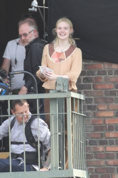 Elle Fanning Photos Photos - Elle Fanning and Peter Dinklage film scenes for their upcoming movie 'Low Down' in Los Angeles. - Elle Fanning and Peter Dinklage 'Low Down' in LA