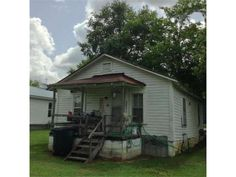 INVESTOR SPECIAL or A GREAT STARTER HOME!!  Great income producing property with tons of potential!  Another parcel available next to this one that has 2 houses & a mobile home - will total 4 rentals!  Property is currently rented.  Do not disturb tenants.  Call or text to schedule showing.  NO REPAIRS, SOLD AS-IS