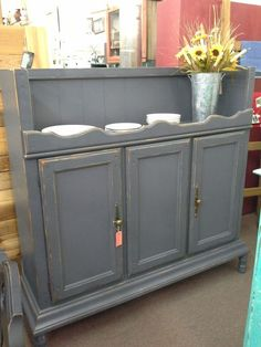 """SOLD - This is a vintage hutch top that has been repurposed as a server. A double door cabinet for storage plus open shelf above for serving or display.  It has been painted in a Opera Gown chalk paint.  Measuring approximately 56"""" across the front by 16"""" deep and stands 52"""" tall.  It can be seen in booth D 11 at Main Street Antique Mall 7260 East Main Street ( E of Power Rd ) Mesa, AZ 85207 480 9241122open 7 days a week 10a.m to 5 : 30p.m Cash, charge or 30 day layaway accepte..."""