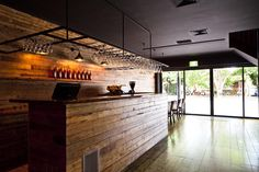The recycled timber bar and matt black ceilings set the mood on arrival.