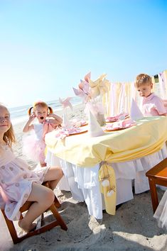 love the layered tablecloth; love the idea of a kids dinner/party on the beach!