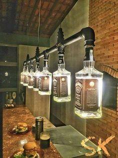 Old Jack Daniels Bottle & plumbing pipe for a sweet industrial style chandelier!