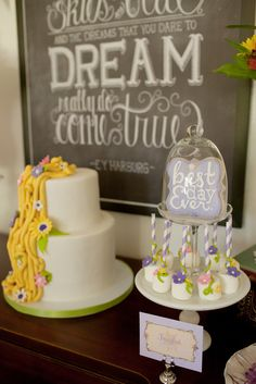 Love this cake and marshmallow pops at a Tangled Party!  See more party ideas at CatchMyParty.com!  #tangled #partyideas