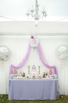 Main party table with draped purple curtain from an Elegant Purple Princess Birthday Party at Kara's Party Ideas.