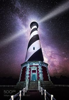 Sentinel  Closeup of the Cape Hatteras Lighthouse with the Milky Way as a back drop.  Tried using a small flashlight to do some light painting on the lighthouse.  It was so dark here at this location that I think the flashlight helped a lot.  Combined eight images in stack to reduce noise.  Used DSS for the stars and median stack mode in photoshop for the lighthouse.  Also took some liberties with the headlight beam :)  Camera: Canon 5D Mark III Lens: Canon 14mm Focal Length: 14mm Shutter…