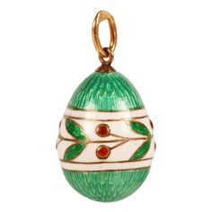 Faberge gold and enamel miniature pendant egg, workmaster Feodor Affanasiev, St Petersburg, circa 1900. The green translucent enamel over a textured engine-turned ground encircled by a wide band of opaque white enamel decorated with green leaves and red cherries.