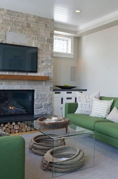 The fireplace dictates the mantel, including how far a wood mantel needs to be from the firebox for safety, and how far it needs to stick out to protect the TV screen from the gas heat.