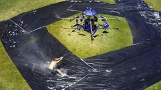 A Homemade Perpetual Slip 'N Slide That Spins People Around in Circles at Dizzying Speeds