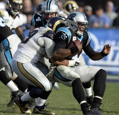 Panthers vs. Rams:  13-10, Panthers  -     Carolina Panthers quarterback Cam Newton (1) gets sacked by Los Angeles Rams defensive tackle Aaron Donald (99) in the second half at Los Angeles Memorial Coliseum in Los Angeles, CA on Sunday, November 6, 2016. The Panthers won, 13-10.