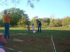 """Corral your animals! Decorated balloons up like farm animals. Have two """"pens"""" set up on either side of playing field. The kids """"corral"""" their animals with new fly swaters across the grass before the balloon pops!"""