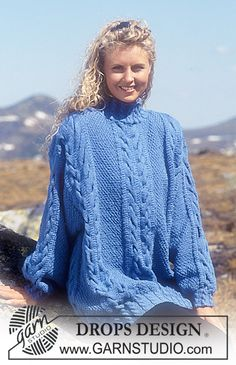 """DROPS sweater with cables and seed stitch in """"Karisma Superwash"""". Long or short version. ~ DROPS Design"""